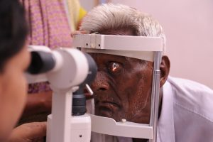 A man has his eyes screened in a rural village in Andhra Pradesh, India.