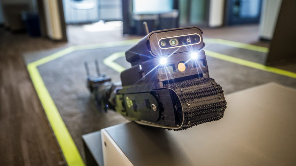 Photo of snake-like robot with two lights on the front